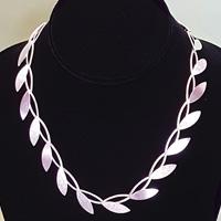 silver necklace at beach treasures