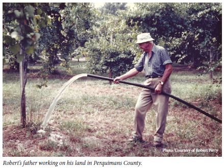 Robert's father working on his land in Perquimans County.