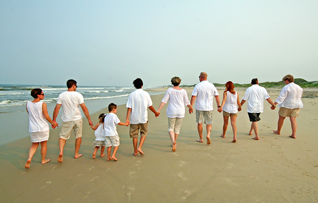 Large family walking on the beach of the Outer Banks North Carolina