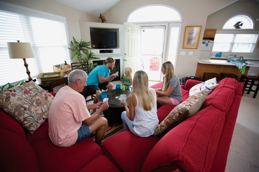 Family at a Brindley Beach Vacations rental home