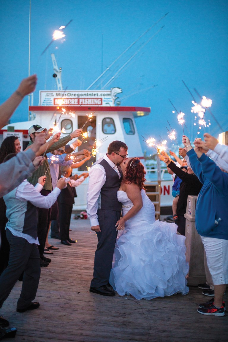 Couple kissing during Miss Oregon Inlet wedding reception