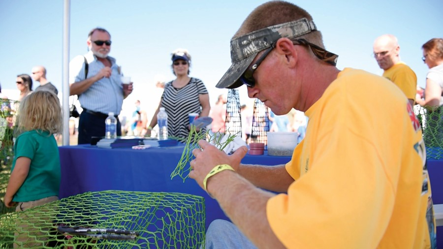 Fisherman working on a crab pot at the Outer Banks Seafood Festival