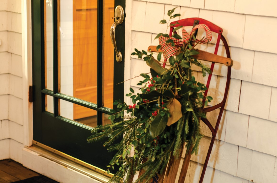 Holiday sleigh on front porch of home
