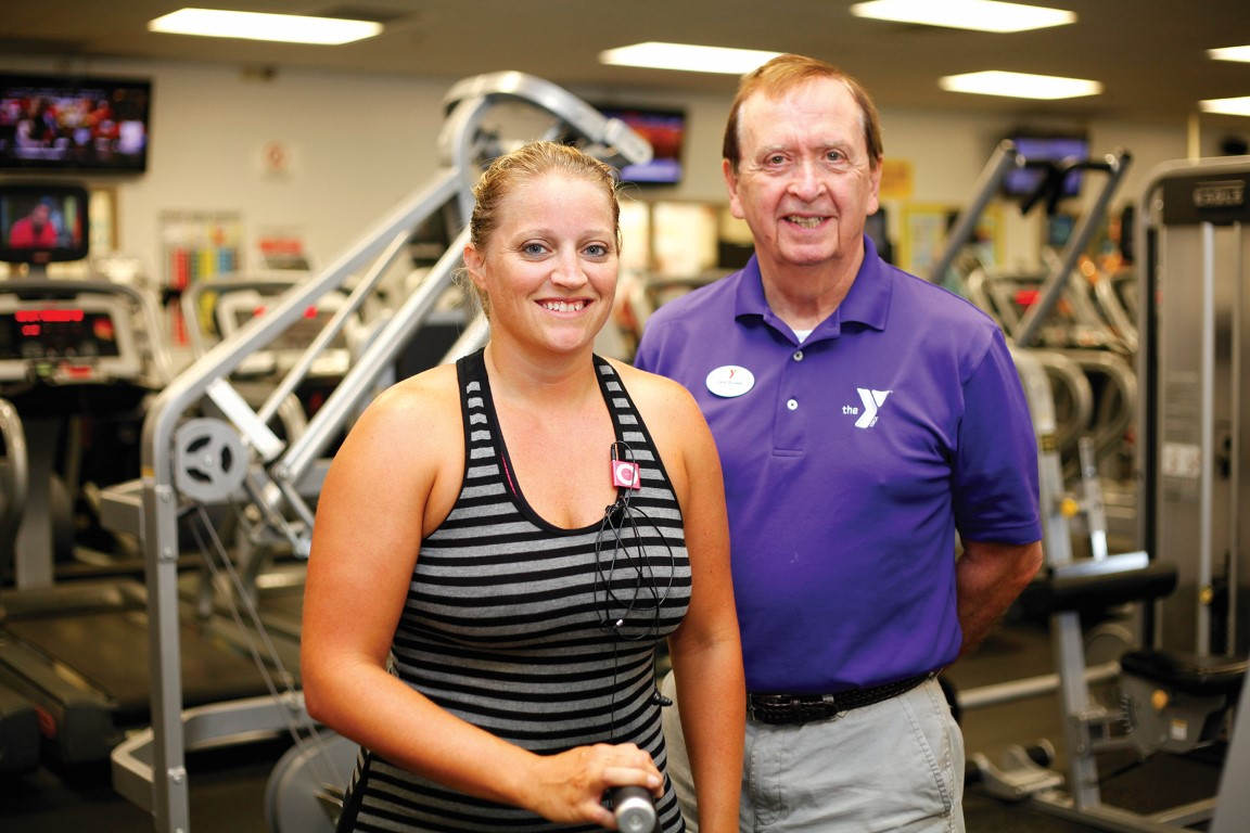 Guest posing with Outer Banks Family YMCA staff member