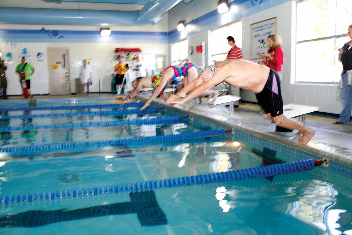 Swimmers diving into pool at the Outer Banks Family YMCA