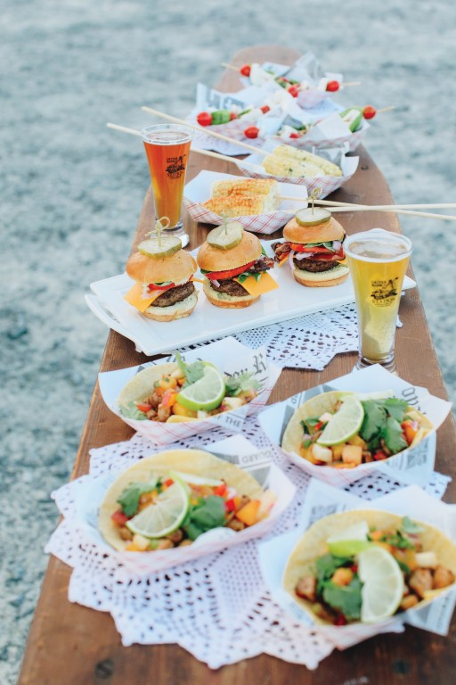 Outer Banks Brewing Station fish tacos, beer and mini burgers on picnic table