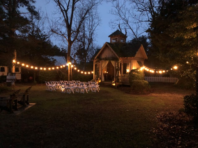 Inn Garden in the Evening with Lighting and Chairs