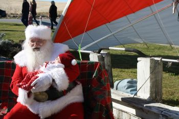 Kitty Hawk Surf Co., Hanging with Santa - Free Photos with Santa