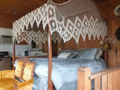 King room with canopy bed at Scarborough Inn