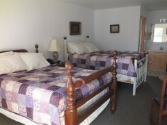 Room with two double beds at Scarborough Inn