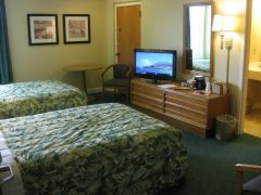 Room with two double beds at Outer Banks Inn