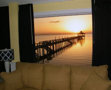 Sunset from a waterfront room at Inn at Corolla Light