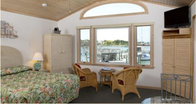 Harbor-front studio suite with a queen bed at Ocracoke Harbor Inn