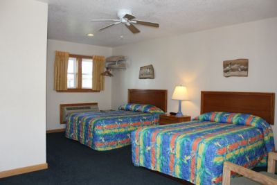 Room with two double beds at Pony Island Motel
